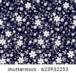 Stock vector floral pattern pretty flowers on dark blue background printing with small white flowers ditsy 623932253