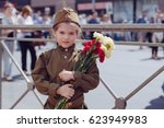 little girl with flowers on the ... | Shutterstock . vector #623949983