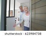 senior people welcoming friends ... | Shutterstock . vector #623984738