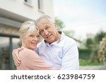 senior couple embracing in... | Shutterstock . vector #623984759