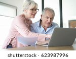 senior couple at home connected ... | Shutterstock . vector #623987996