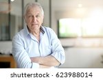 portrait of senior man standing ...   Shutterstock . vector #623988014