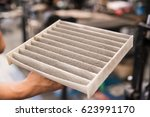 close up used air filter of car. | Shutterstock . vector #623991170