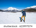man photographed mountains in... | Shutterstock . vector #623997074