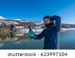 man photographed mountains in... | Shutterstock . vector #623997104