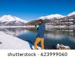 man photographed mountains in... | Shutterstock . vector #623999060