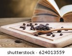 coffee beans in wooden spoon... | Shutterstock . vector #624013559