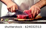 Man cutting beef meat.