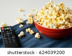 popcorn in red bowl with tv... | Shutterstock . vector #624039200