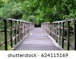 The Wood Bridge In The Green...