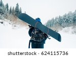 sportsman go with snowboard... | Shutterstock . vector #624115736