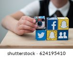 teenager boy folds cubes with... | Shutterstock . vector #624195410