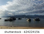 fishing boats on the beach in... | Shutterstock . vector #624224156