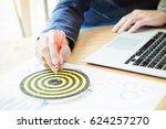 businessman holding a darts... | Shutterstock . vector #624257270