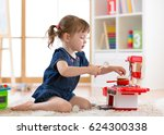 pretty kid girl playing with a... | Shutterstock . vector #624300338