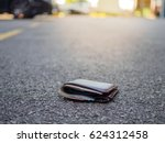 wallet with money drop on the... | Shutterstock . vector #624312458