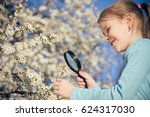happy little girl exploring... | Shutterstock . vector #624317030