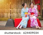 best girlfriends sitting on the ... | Shutterstock . vector #624409034