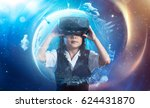 Stock photo little asian cute girl wearing virtual reality goggles with amazing cosmic futuristic space virtual 624431870