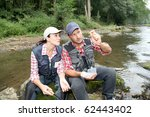 Man And Woman Fly Fishing In...