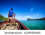 fisherman standing on a boat in ... | Shutterstock . vector #624456464