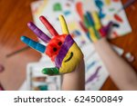 painted hand with smiley | Shutterstock . vector #624500849