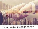 partners shaking hands . mixed... | Shutterstock . vector #624505328