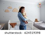 mother comforting newborn baby... | Shutterstock . vector #624519398