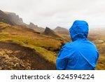 Man In Rain Jacket At Quiraing...