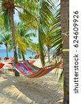 hammock hanging between palm... | Shutterstock . vector #624609926