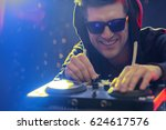 Dj Working At Nightclub  Mixin...