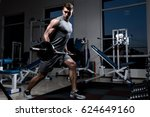 young muscular man in a vest... | Shutterstock . vector #624649160