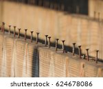 Row Of Screws Protruding From...