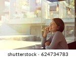 beautiful asian woman drinking... | Shutterstock . vector #624734783
