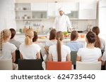 group of people at cooking... | Shutterstock . vector #624735440