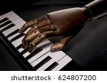 Small photo of Black hand for a music accord on a keyboard in a jazz ambience. With dark background. With copy space text. Studio Shot.