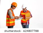 two engineers examining plans... | Shutterstock . vector #624807788