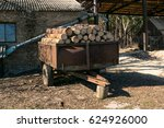 Old Wooden Cart With Logs