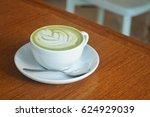 hot matcha tea and latte art in ... | Shutterstock . vector #624929039