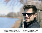 man looking at camera with... | Shutterstock . vector #624938669