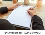 hands of woman writing blank