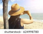 woman taking a photo of an... | Shutterstock . vector #624998780