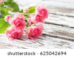 pink roses on a wooden... | Shutterstock . vector #625042694