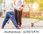 a boy is learning tennis with... | Shutterstock . vector #625071974