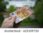 man holding new 50 euro... | Shutterstock . vector #625109720
