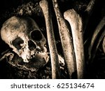 Small photo of Skull and skeleton at the burial site in Sulawesi, Indonesia. It is their tradition to keep the dead body in the cave instead of burying beneath the ground