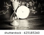 hourglass against on wooden... | Shutterstock . vector #625185260