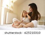mother with her cute little... | Shutterstock . vector #625210310