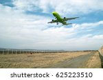 Small photo of Burgas airport, Bulgaria - April 19, 2015: Green passenger airliner landing on the runway of the airport against beautiful cloudy sky. S7 Airlines (Siberia Airlines) is a Russian airline company.