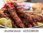 grilled meat skewers and pita... | Shutterstock . vector #625238030